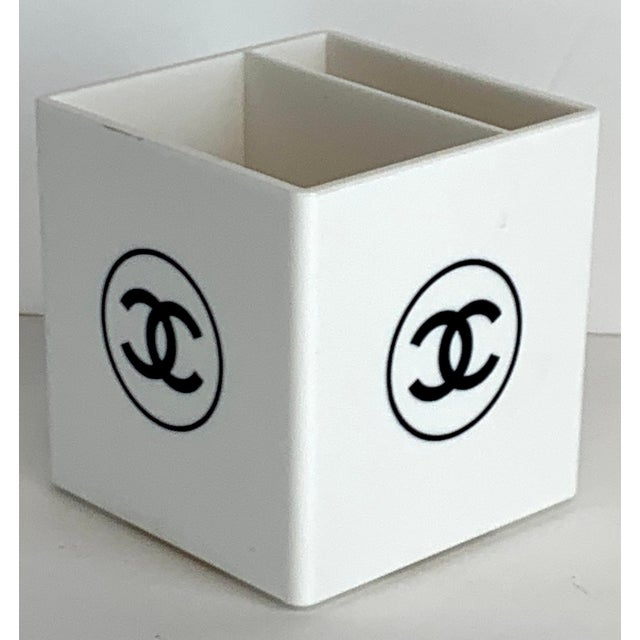 "Chanel store display make up brush /pen holder, with divided interior 1"" x 3"" and 2"" x 3"" sections. The logo appears on..."