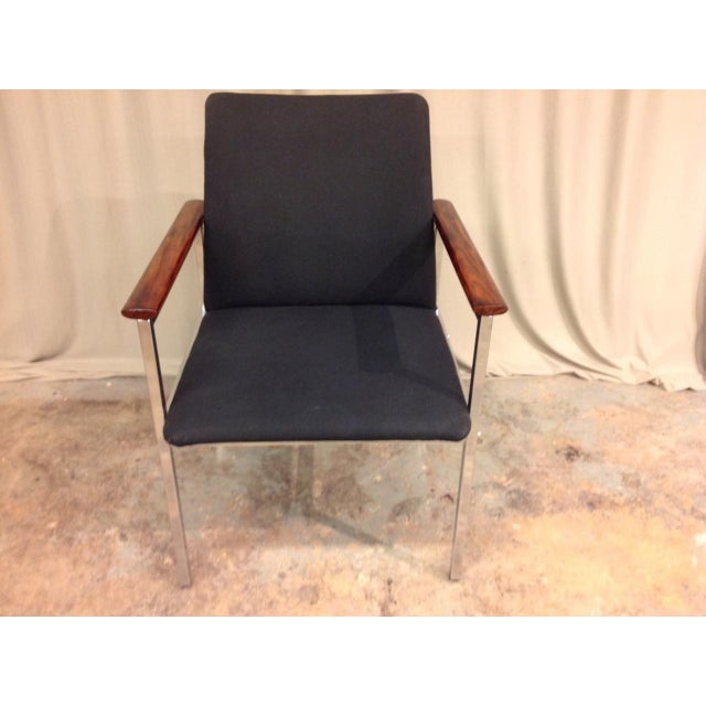 Set of six French Mid-Century chrome and wood armchairs.
