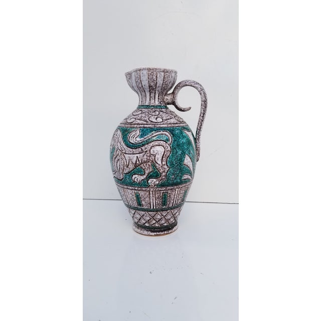 Vintage mid-century modern art handmade and painted Italian decorative Ceramic Vase. Marked on the bottom -MADE IN ITALY,...