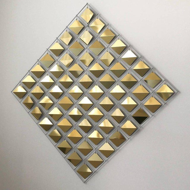 """Curtis Jere brass diamond shaped wall sculpture. 64 faceted brass diamonds are suspended from a chrome framework. The 3""""..."""