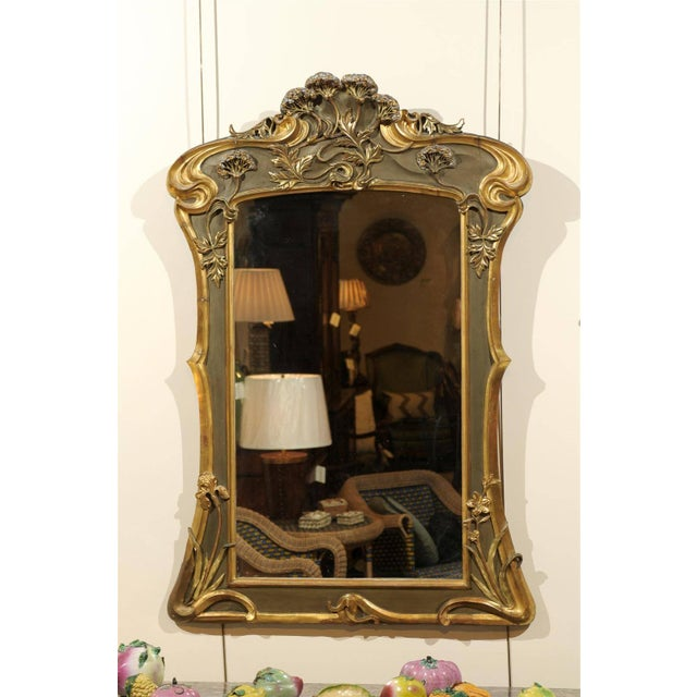 Art Nouveau Style Mirror in Gold and Taupe, circa 1950 Flowers, flowers everywhere! Our Art Nouveau style mirror has many...