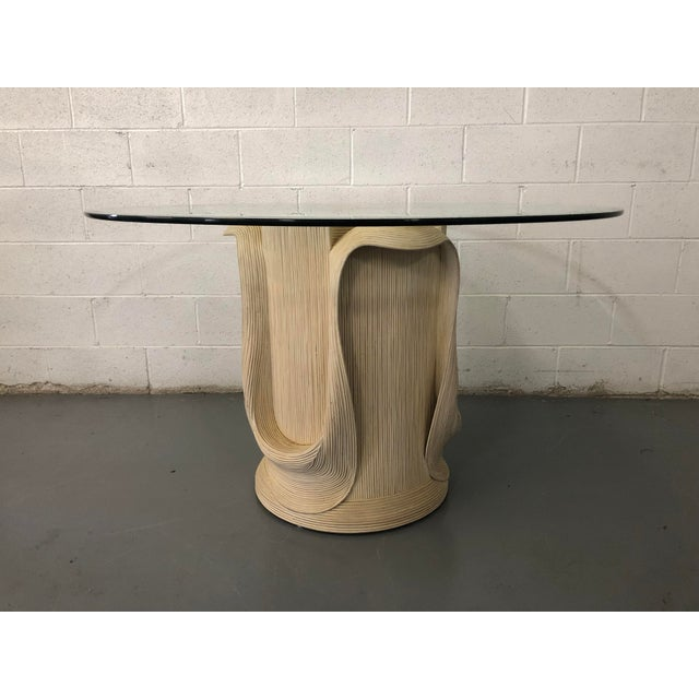 "Beautiful reed rattan sculpted dining table with glass top by Betty Cobonpue from her Scultura collection. The base is 29""..."