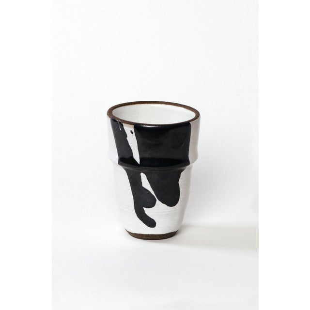 "Black and white ceramic cup handmade in Los Angeles. height: 4 1/2"" diameter: 3 1/4"""