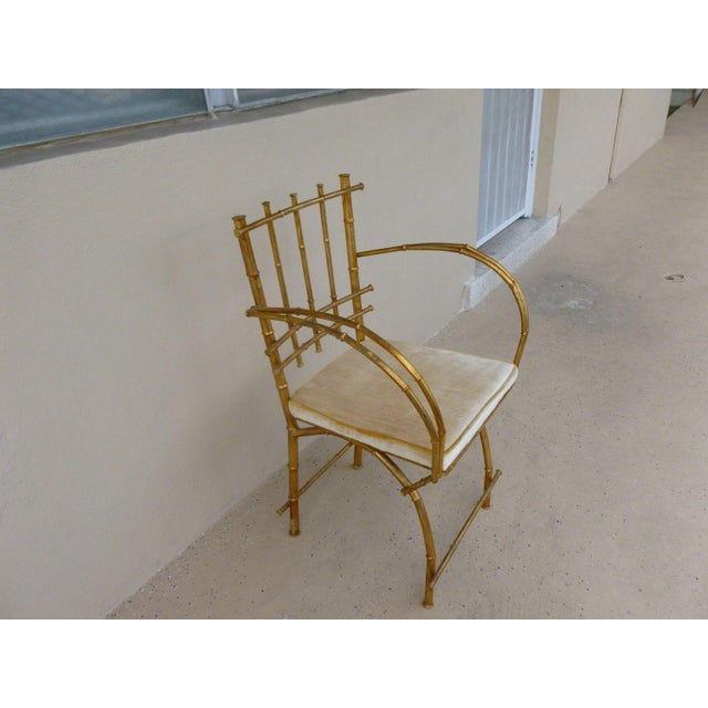 This is a wonderful Italian Hollywood Regency style gilt tole faux bamboo armchair. The piece dates back to the 1960s.