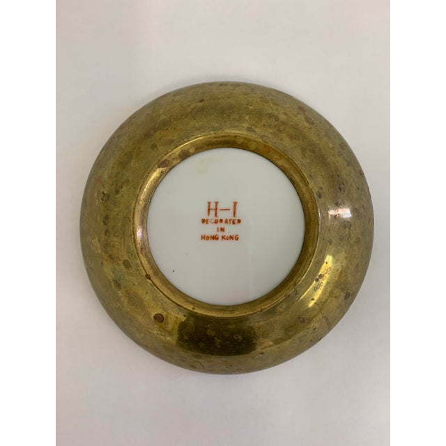 This vintage bowl is unique as it is encased in brass. The brass shows around the edges, and brings out the beautiful...