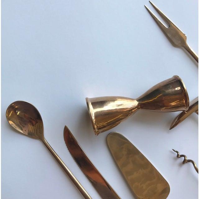 Set of 7 brass bar tools including stirrer spoon, cocktail fork, knife, bottle opener / ice pick, jigger, corkscrew and...