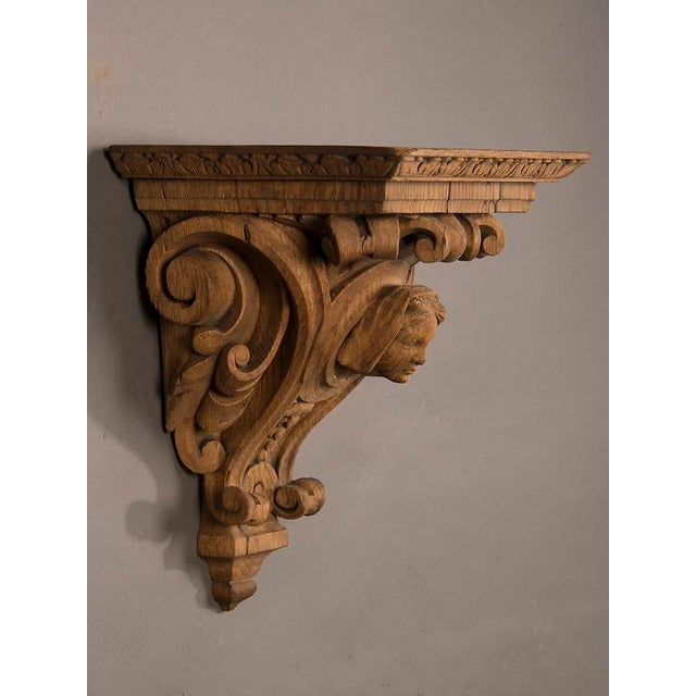 Henri II style oak wall bracket featuring a portrait bust of a beautiful young lady having robust carving and a large...