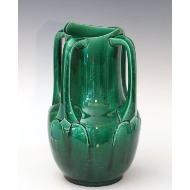 Awaji Pottery vase in architectural Art Nouveau form with four applied buttress handles and deep green monochrome glaze,...