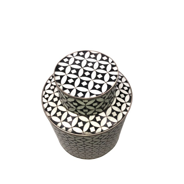 A cloisonné black and white tea jar canister in a rare geometric design by Fabienne Jouvin, a French artist passionate...