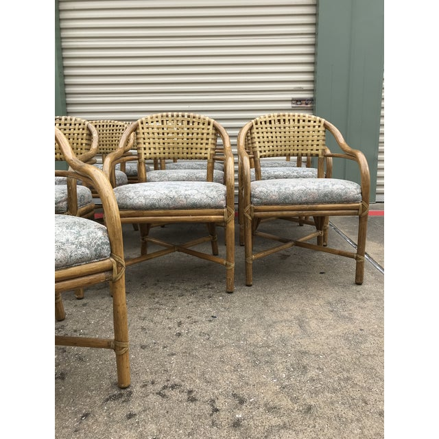 Gorgeous, heirloom-quality vintage chairs in an incredible set of 10. Backs are woven leather, rattan is sturdily tied...