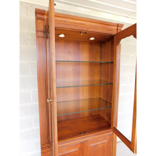 Features Fine High Quality Construction, Solid Cherry, Adjustable Wood Shelve on Lower Area, Brass Hardware, Beveled Glass...