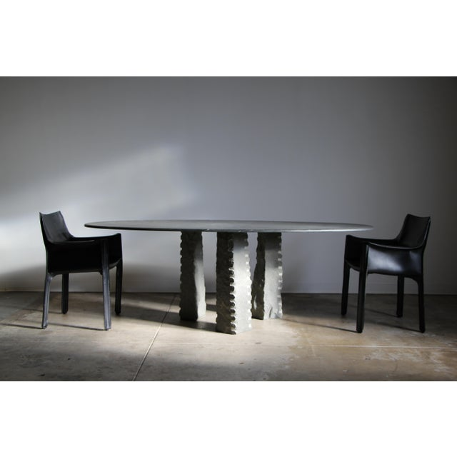 An exceptional vintage Italian stone and slate top dining table. We-re not sure who designed this, but it is a seriously...