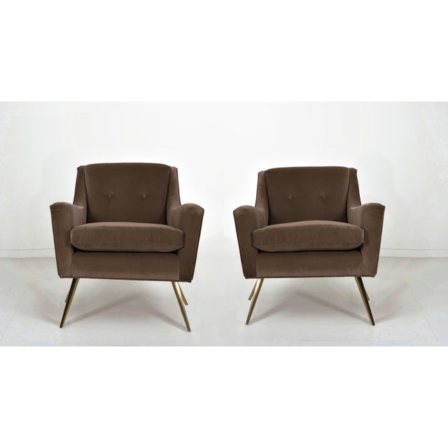 Unique pair of modern chairs with brass legs - refinished in tan doeskin cotton velvet. Professionally reupholstered. Seat...
