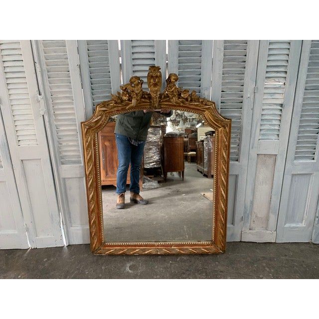 Beautiful Louis XVI giltwood mirror with original frame and original glass. The outer frame is etched with floral and...
