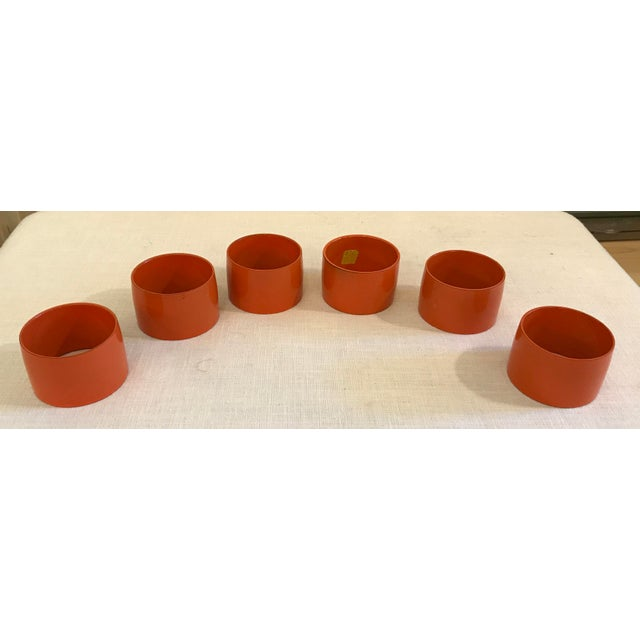 Nice set of six(6) mid century Napkin Rings in tangerine. Some wear/color loss on the edge of a few of them. I believe...