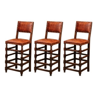 Set of Three 19th Century French Carved Oak and Brown Leather Bar Stools For Sale