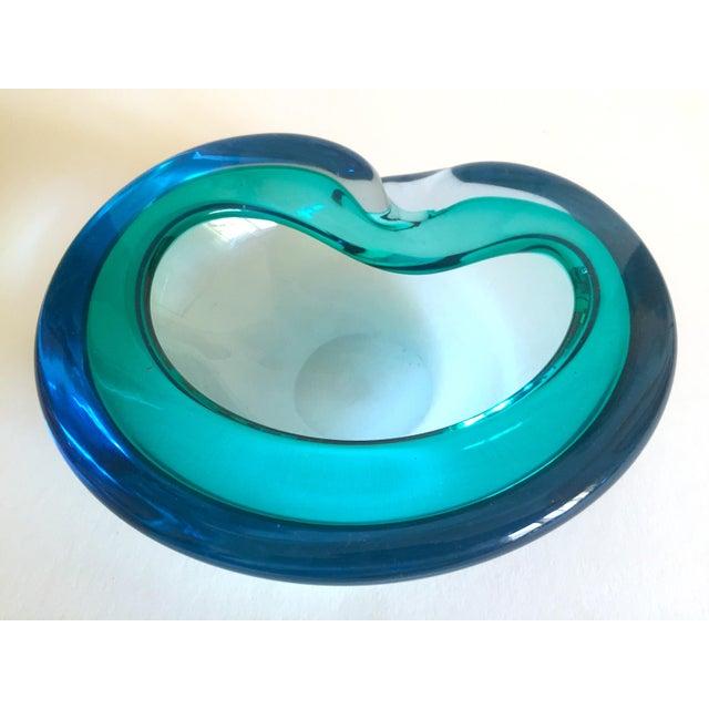 This vintage Mid Century Modern rare Flavio Poli for Seguso Vetri D'Arte Murano art glass sommerso bowl ashtray is an...