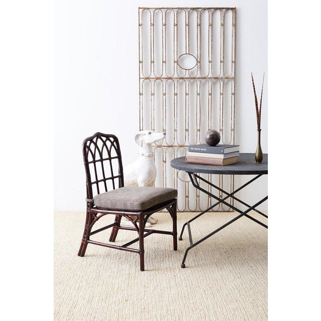 Stylish set of four McGuire bamboo rattan dining chairs featuring a rare option lacquered finish. Authentic cathedral...