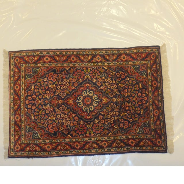 This handmade, fine Persian Sarouk rug is sure to add sophistication and an ethnic elegance to any space. It has a plush...