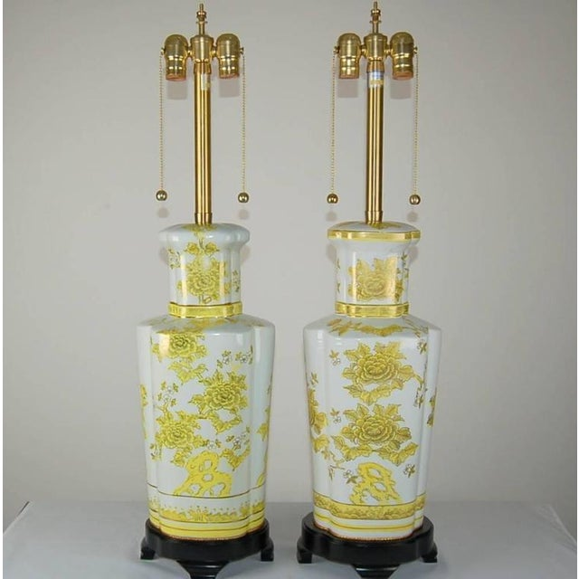 Beautiful pair of hand-painted Porcelain lamps imported by Marbro. Colors are CANARY YELLOW over white, in perfect...