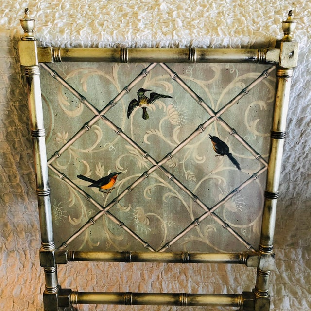 A lovely English Traditional style painted fireplace screen in silvered wood with a trellised chinoiserie motif on front...