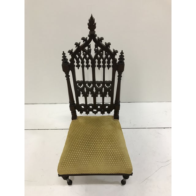 Beautify hand crafted Gothic side chair of solid walnut. No breaks chips or damage to wood or fabric. Fabric is a textured...