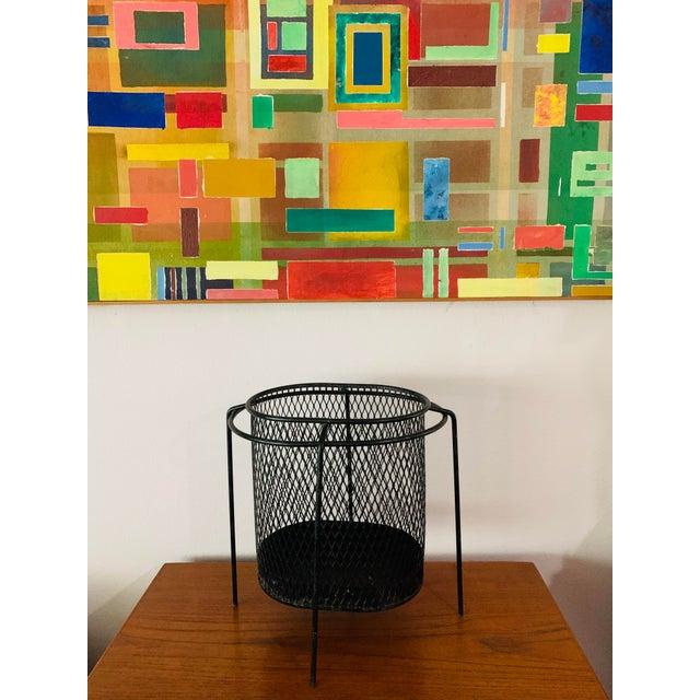 Mid-century modern wonderful iconic design: floating iron and steel mesh waste basket designed by Maurice Duchin. Circa...