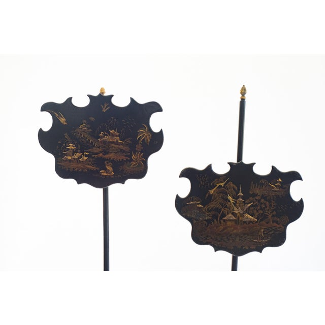 The height of the Chinoiserie shields on these pole screens is adjustable. Placed in front of a fire, the purpose of the...