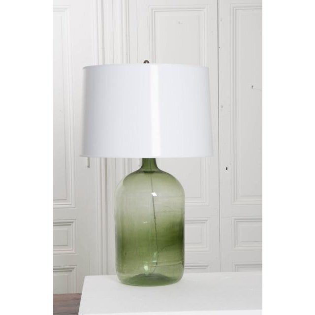 """A wonderful antique green-glass wine keg, or """"demijohn"""", that has recently been made into a fantastic table lamp. Once..."""
