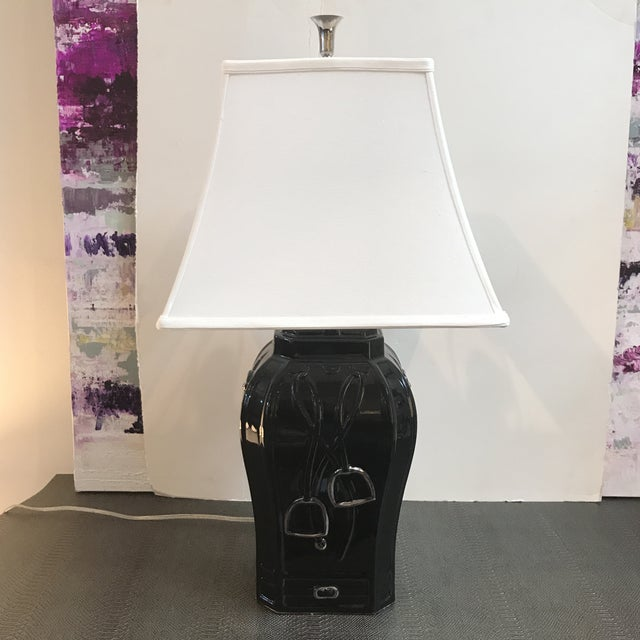 Equestrian style porcelain lamp. Comes with an off-white sculpted shade and nickel finial. From Chelsea House.