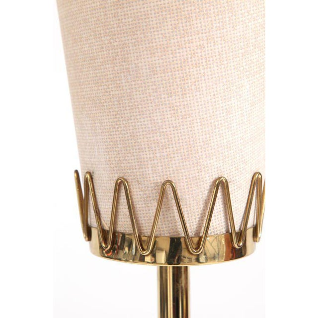 Brass and parchment floor lamp from Italy, circa late 1950s. This example has four subtly tapered legs brass body and...