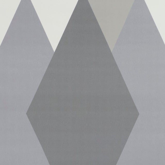 A modernist collage of geometric shapes, this extra-large wallpaper design creates a striking, mural-like effect. It is...