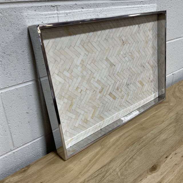 This is a vintage Regina Andrew Designs bone Inlay tray with chrome frame. The bone inlay is in a beautiful herringbone...