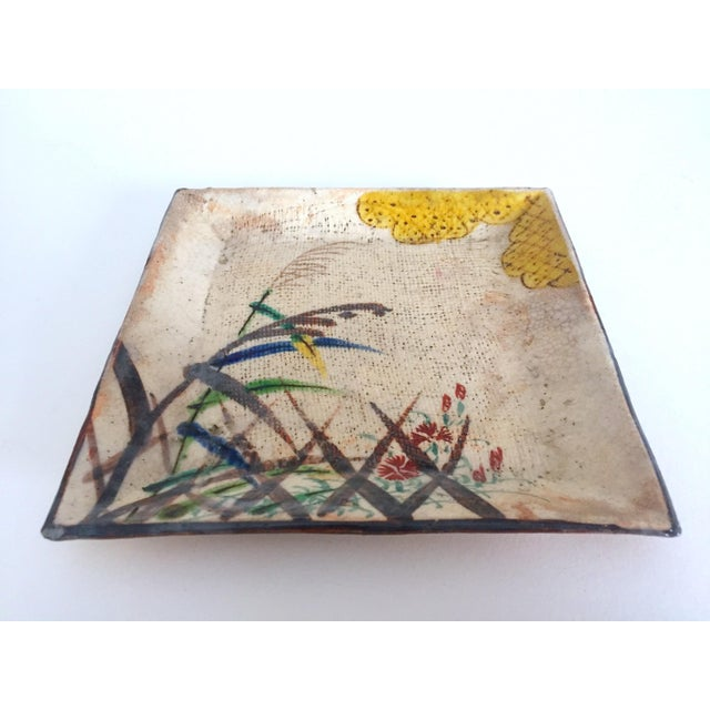 This vintage Mid Century japan studio art pottery square pressed hand painted artisan ceramic plate dish is a very special...