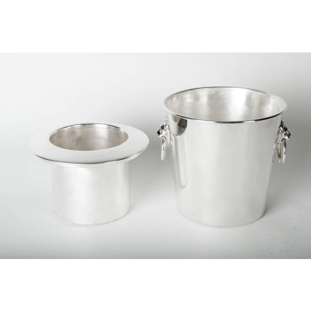 Vintage English silver plated wine cooler / ice bucket with two side handles. The wine cooler / ice bucket is in excellent...