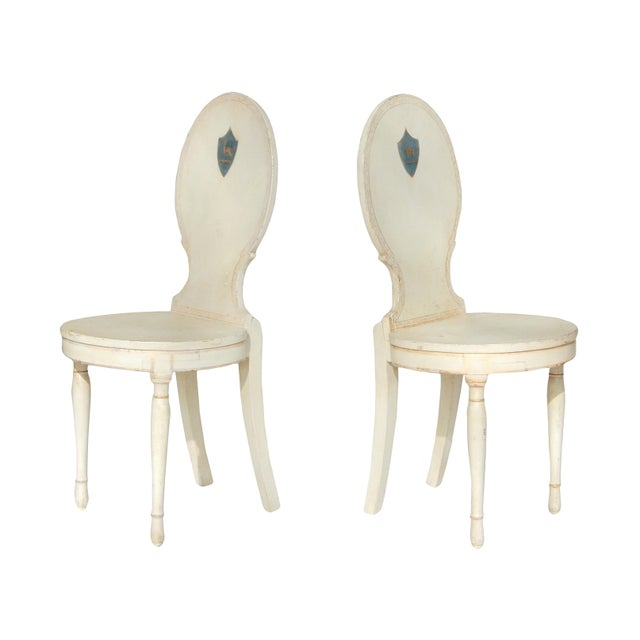 Beautiful pair of unusual Swedish side chairs - with painted crest.