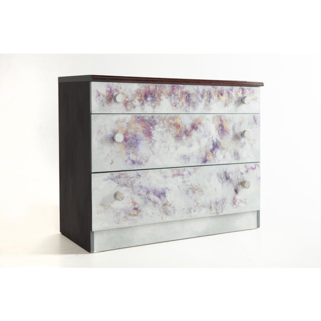 This effervescent hand-painted chest of drawers is designed by Atelier MIRU. The drawers are executed in wood, soaked into...