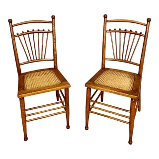 Pair of Antique Oak and Pressed Cane Dining Chairs For Sale