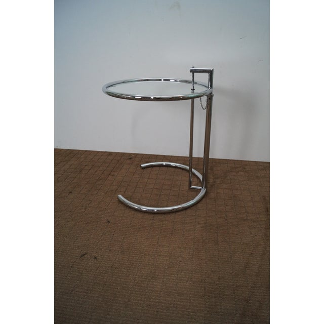 Eileen Gray Adjustable Chrome & Glass Round Side Table. Approx 25 years, Italy. Quality, chromed, tubular steel frame side...