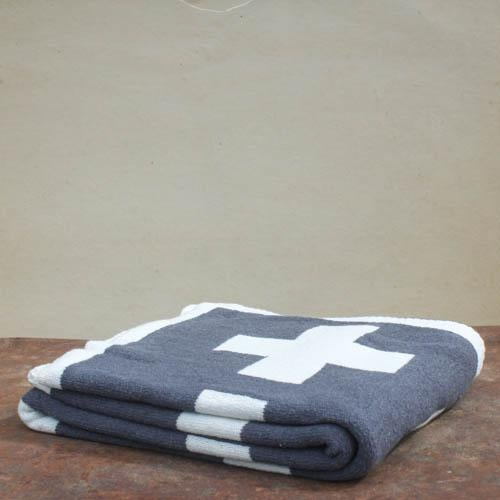 This throw is woven in upstate New York using organic cotton. The modern Swiss Cross pattern is a fantastic design...