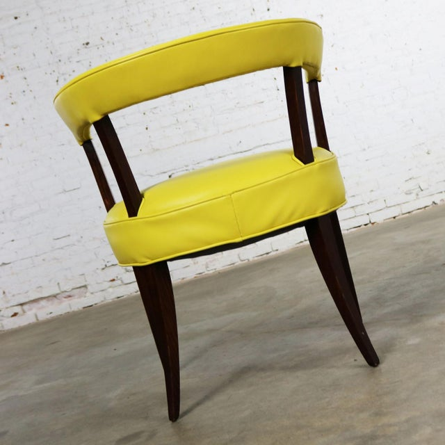 Awesome mid-century modern rosewood stained oak barrel back side chair with its original lemon-yellow vinyl upholstery. It...