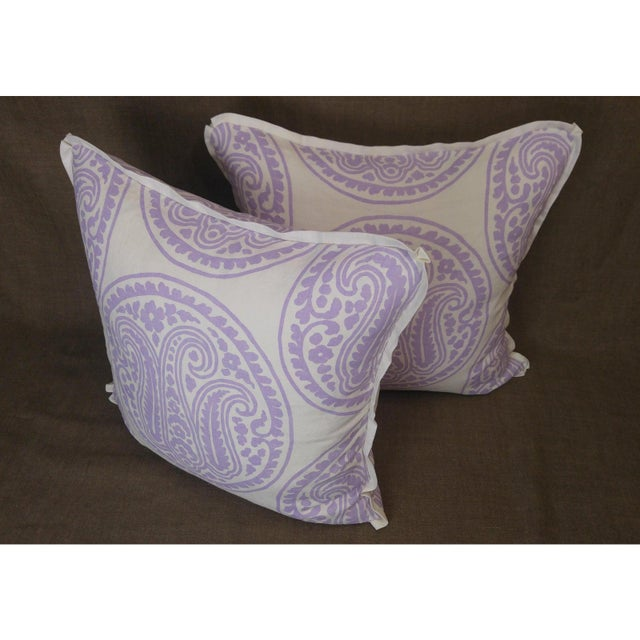 Pair of Raoul Textiles throw pillows in Mira white linen print, lilac colorway, flat welt with pinched corner and zipper,...