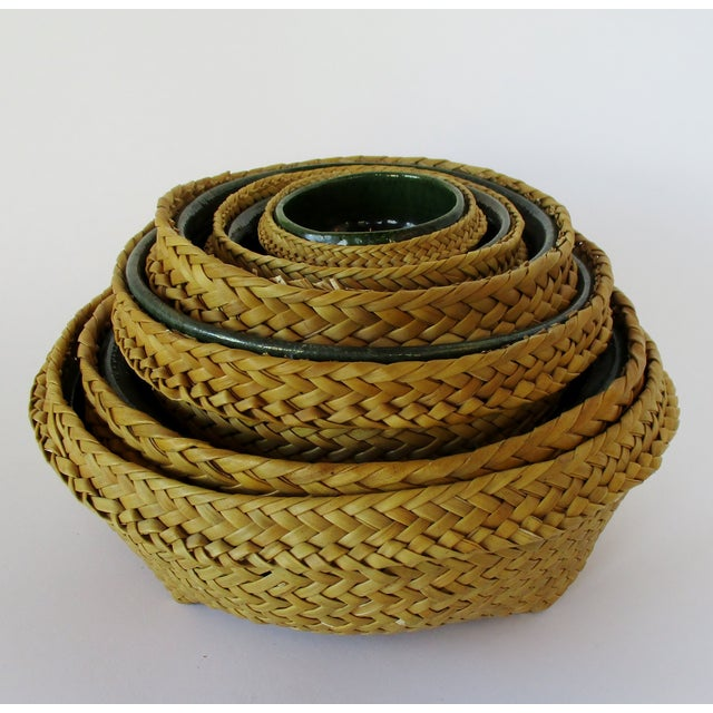 Set of 6 Mexican handmade dark green rustic ceramic nesting bowls with woven wicker surrounds. Unknown if glaze is food...