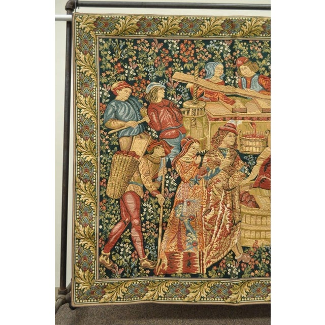 Item: French wall hanging tapestry featuring the left panel of a 15th Century Tournai design of Vendages (Winemakers) on a...