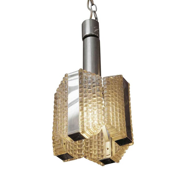1960s vintage modern style pendant hanging fixture with chrome detail and textured waffle glass. This has one single socket.