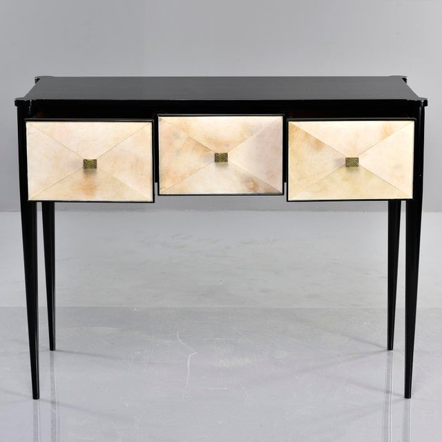 Custom created by English cabinet maker, this console has an ebonized wood frame with tapered legs and three functional...