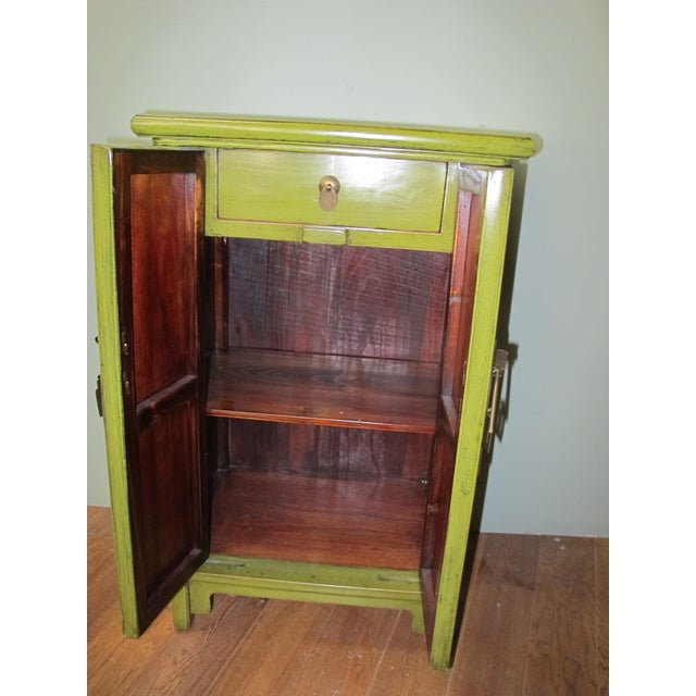 "Lime green lacquer finish on this chest, serves well as a ""pop of color"" in just about any setting. Made of reclaimed..."
