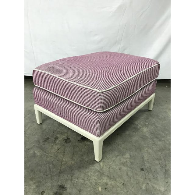 The Billy Ottoman is a first quality market sample that features an Ultra Down Seat Cushion. It comes in a Wine Fabric...