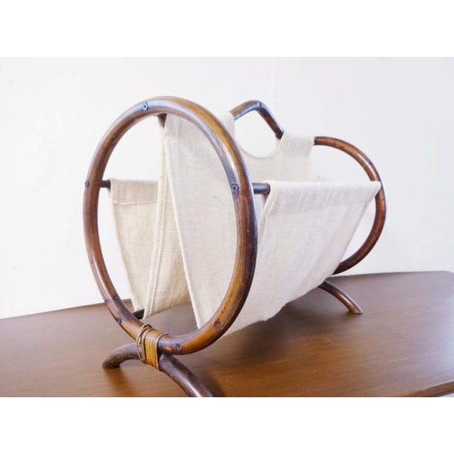Great boho chic magazine holder, made of dark stained rattan and burlap. Cute hoop design with little curved legs. The...