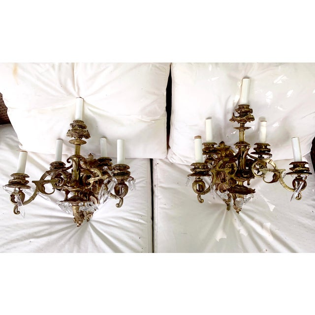 Pair of English Rosebud Gilt, Bronze and Crystal Sconces, Circa 1800. Consists of heavy cast bronze and crystal. They have...